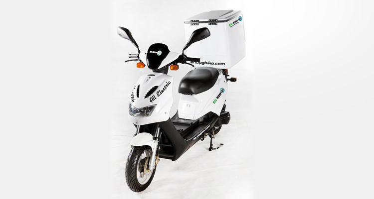 Angle shot of white commercial delivery scooter